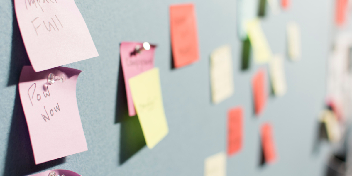 Post-its on wall depicting process documentation