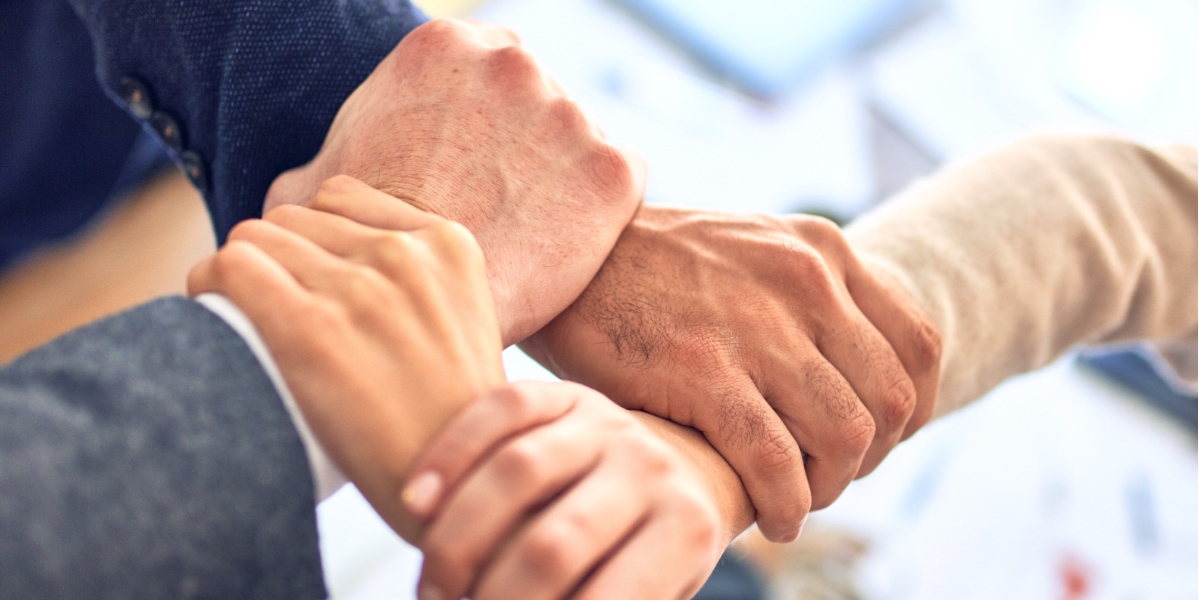 Hands clasped indicating innovation leadership